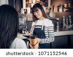 asia barista waiter take order... | Shutterstock . vector #1071152546