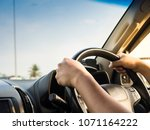 Man\'s Hands Holding Steering...