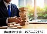 businessman pick wooden block... | Shutterstock . vector #1071170672