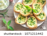 toasted bread with garlic and... | Shutterstock . vector #1071211442
