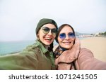 mother and adult daughter are... | Shutterstock . vector #1071241505