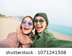 mother and adult daughter are... | Shutterstock . vector #1071241508