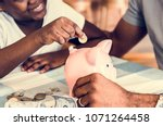 dad and daughter saving money... | Shutterstock . vector #1071264458