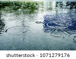 big puddle  the rain drops... | Shutterstock . vector #1071279176