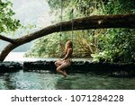 a young woman in blue lagoon in ... | Shutterstock . vector #1071284228