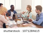 business meeting of young... | Shutterstock . vector #1071284615