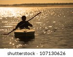 Silhouette Of A Man Rowing In...