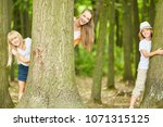 mother and two kids have fun... | Shutterstock . vector #1071315125