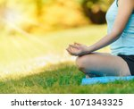 one woman is meditating as part ... | Shutterstock . vector #1071343325
