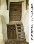 Small photo of Romania, living quarters in the courtyard of the fortified church Prejmer, wooden doors with hearts and wooden ladder