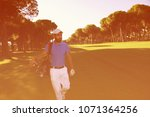 handsome middle eastern golf... | Shutterstock . vector #1071364256