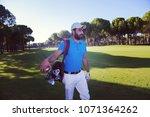 handsome middle eastern golf... | Shutterstock . vector #1071364262
