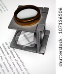 Detail of text and loupe lens on an offset printed sheet - stock photo