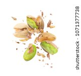 pistachio crushed in the air... | Shutterstock . vector #1071377738