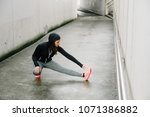 sporty woman stretching and... | Shutterstock . vector #1071386882