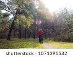 cyclist riding the mountain... | Shutterstock . vector #1071391532