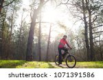 cyclist riding the mountain... | Shutterstock . vector #1071391586