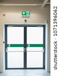 emergency exit in the store | Shutterstock . vector #1071396062