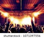 concert crowd in a huge arena... | Shutterstock . vector #1071397556