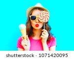 cool girl making an air kiss... | Shutterstock . vector #1071420095