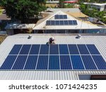 solar panel technician with...   Shutterstock . vector #1071424235