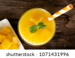 mango smoothies  juice and...   Shutterstock . vector #1071431996
