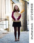 french girl with baguettes on... | Shutterstock . vector #1071458408