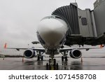 passenger plane parked at the... | Shutterstock . vector #1071458708