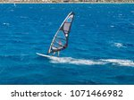 the windsurfer on the board... | Shutterstock . vector #1071466982
