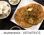 stuffed paneer paratha with... | Shutterstock . vector #1071475172