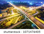 overpass and busy traffic in... | Shutterstock . vector #1071476405