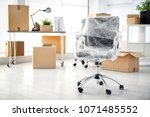 moving boxes and furniture in... | Shutterstock . vector #1071485552