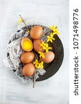 brown hen's eggs decorates with ... | Shutterstock . vector #1071498776