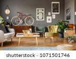 art collection on a grey wall ... | Shutterstock . vector #1071501746