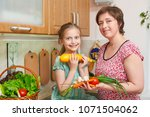 mother and daughter with basket ...   Shutterstock . vector #1071504062