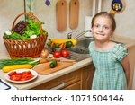 child girl cooking in home...   Shutterstock . vector #1071504146