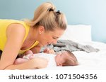 beautiful  young mother with... | Shutterstock . vector #1071504356