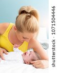 beautiful  young mother with... | Shutterstock . vector #1071504446