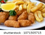 home made scampi and chips... | Shutterstock . vector #1071505715