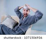 guy in bathrobe  dancing or... | Shutterstock . vector #1071506936