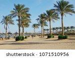 beautiful sunny beach. a row of ... | Shutterstock . vector #1071510956