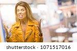 beautiful young woman terrified ...   Shutterstock . vector #1071517016