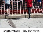 athletes running on a course | Shutterstock . vector #1071544046