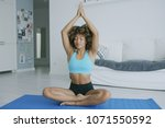 concentrated young woman in...   Shutterstock . vector #1071550592