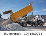 Dump truck unloading process, - stock photo