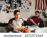 teenage boys hanging out in a... | Shutterstock . vector #1071571565