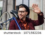 handsome fashionable man waving ... | Shutterstock . vector #1071582236