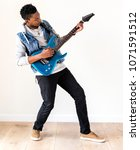 Small photo of African descent man playing electric guitar