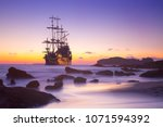 pirate ship at the open sea at... | Shutterstock . vector #1071594392