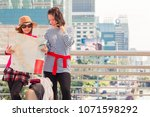 two woman traveller standing... | Shutterstock . vector #1071598292